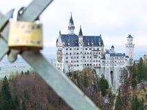 Neuschwanstein Castle and love lock. On a bridge in Germany stock image