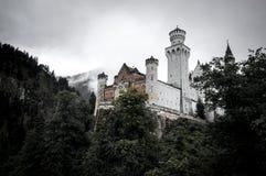 Neuschwanstein Castle in mist. Neuschwanstein Castle shrouded in mist in the Bavarian Alps of Germany Royalty Free Stock Photo