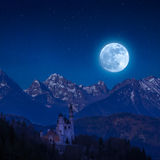 Neuschwanstein Castle in Moon Light. Landscape with stars over mountain, Bavaria Royalty Free Stock Image