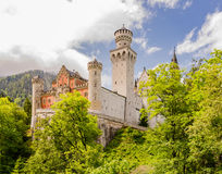 Neuschwanstein Castle is a nineteenth-century Romanesque Revival palace in Bavaria, Germany. Neuschwanstein Castle is a nineteenth-century Romanesque Revival Royalty Free Stock Images