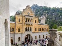 Neuschwanstein Castle is a nineteenth-century Romanesque Revival palace in Bavaria, Germany. SCHWANGAU, GERMANY - JUNE 6, 2016: Neuschwanstein Castle is a Stock Photos