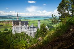 Neuschwanstein Castle is palace near Fussen in Bavaria. Neuschwanstein Castle is a 19th-century Romanesque Revival palace near Fussen in southwest Bavaria royalty free stock photography
