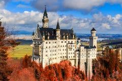 Neuschwanstein Castle with red foliage, Schwangau, Germany.  Royalty Free Stock Photography