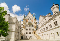 Neuschwanstein Castle is a Romanesque Revival palace near Fussen in southwest Bavaria, Germany. Neuschwanstein Castle is a nineteenth-century Romanesque Revival Stock Photos
