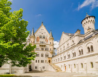 Neuschwanstein Castle is a Romanesque Revival palace near Fussen in southwest Bavaria, Germany. Neuschwanstein Castle is a nineteenth-century Romanesque Revival Royalty Free Stock Photos