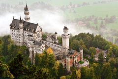 Neuschwanstein Castle. Shrouded in mist in the Bavarian Alps of Germany stock images