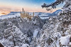 Neuschwanstein Castle during sunrise in winter landscape. Germany stock images