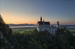 Neuschwanstein castle at sunset Royalty Free Stock Photos