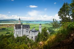 Neuschwanstein Castle is palace near Fussen in Bavaria. Neuschwanstein Castle is a 19th-century Romanesque Revival palace near Fussen in southwest Bavaria royalty free stock images