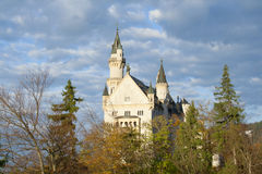 Neuschwanstein castle in trees stock photos
