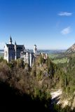 Neuschwanstein Castle in the valley. New Swanstone Castle is a nineteenth-century Romanesque Revival palace on a rugged hill above the village of Hohenschwangau stock images