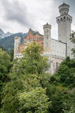 Neuschwanstein castle. View of the Neuschwanstein castle in Bavaria from below with a cloudy sky Stock Image
