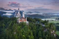 Neuschwanstein Castle. View of Neuschwanstein Castle, Germany during foggy summer morning stock photo