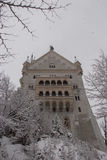 Neuschwanstein Castle in winter time between trees. Fussen. Germany. Close up view. Royalty Free Stock Photography