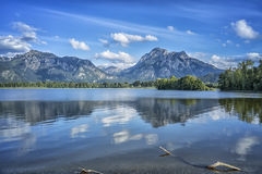 Neuschwanstein at Forggensee lake Stock Photo