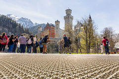 Neuschwanstein, Germany - April 21, 2016: View from the platform to famous Neuschwanstein Castle, panorama view Stock Photo