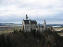 Neuschweinstein and forest. Neuschweinstein Castle view with the forest below - Germany stock images
