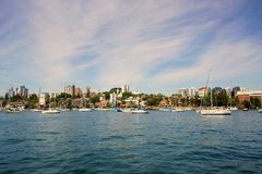 Neutral Bay, Sydney Harbour, Australia. View of Neutral Bay, with anchored white yachts, from a Sydney harbour ferry, Sydney North Shore, NSW, Australia, with royalty free stock images