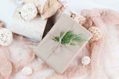 Holiday gift wrapped in brown paper Stock Image