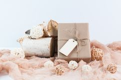 Holiday gift wrapped in brown paper Stock Photo