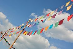 Neutral colored fluttering flags Royalty Free Stock Images