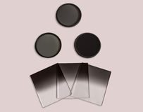 Neutral density and graduated neutral density filters used in camera for photography isolated. Royalty Free Stock Photo