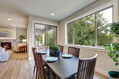 Neutral dining room interior fitted with black dining table Royalty Free Stock Photography