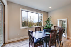 Neutral dining room interior fitted with black dining table Stock Image