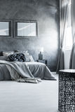 Neutral gray bedroom interior design. Bright and spacious master bedroom with neutral gray interior design royalty free stock photography