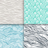 Neutral hand drawn doodle seamless patterns set Stock Photos