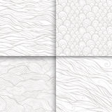 Neutral monochrome doodle seamless patterns set Stock Images