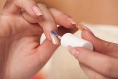 Neutral nail polish Stock Images