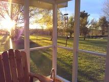 Neutral. Backporch sun sunlight windchimes pond grass trees stock photos