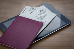 Neutral Passport with Tickets on Tablet Stock Photography