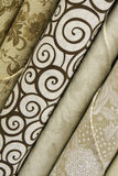Neutral Quilt Fabric. Fabric bolts of neutral quilt fabric in white, brown and beige with abstract designs royalty free stock photography