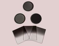 Neutral täthet och avlade examen neutrala täthetfilter som in camera används för isolerat fotografi Royaltyfri Foto