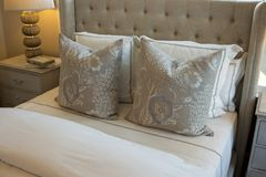 Neutral Themed Bedding and Linens. Neutral, beige themed bedding, pillows, cushions and linens royalty free stock photography