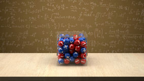 Neutron box in front of physics board. Neutron box with proton and electron Royalty Free Stock Images
