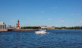 Neva with boat and Spit of Vasilyevsky Island Stock Photo