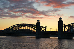 Neva river and Bridge Peter the Great at sunset Royalty Free Stock Photo