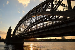 Neva river and Bridge Peter the Great at sunset Royalty Free Stock Photos