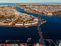 Neva river in early Sunny morning, Palace and other bridges, spit of Vasilievsky island, Rostral columns from bird`s eye view. Neva river in early Sunny morning royalty free stock photos