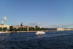 The Neva river. Horizontal landscape with view of Palace Embankment with Admiralty and Isaak's cathedral and white ship on the river in Saint-Petersburg Russia Stock Photography