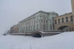 Neva river in ice. Embankment of Winter Canal with Arch and Hermitage Bridge, scenic landmark in St. Petersburg. Russia royalty free stock images