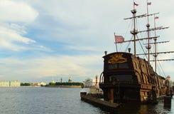 The Neva river, sailing ship and an arrow of Vasilevsky island Stock Photos