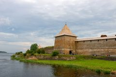 The Neva River and the Sovereign Tower. Fortress in the source of the Neva River, Russia, Shlisselburg: Fortress Oreshek. Medieval Russian defensive structure Royalty Free Stock Images