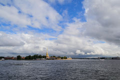 The Neva river in St. Petersburg, Petropavlovskaya fortress. View of the city from the river Neva. Clouds over the river. Clouds over the city. The Royalty Free Stock Image