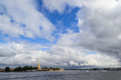 The Neva river in St. Petersburg, Petropavlovskaya fortress. View of the city from the river Neva. Clouds over the river. Clouds over the city. The stock photography
