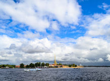 The Neva river in St. Petersburg, Petropavlovskaya fortress. View of the city from the river Neva. Clouds over the river. Clouds over the city. The Royalty Free Stock Photos