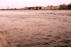 The Neva river water flows. Factory tubes. Sepia tone photo. Stock Photo